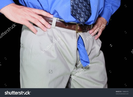 stock-photo-man-with-shirt-tail-out-zipper-13886470